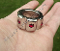 KNUCKLED™ GLANS RING WITH RED SWAROVSKI CRYSTALS